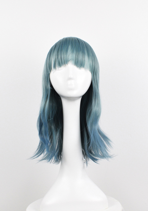 Green and blue long straight wig with bangs. Grunge comes in washed-out muted tones of teal with hues of pale blues from roots to ends. Sleek and poker straight.