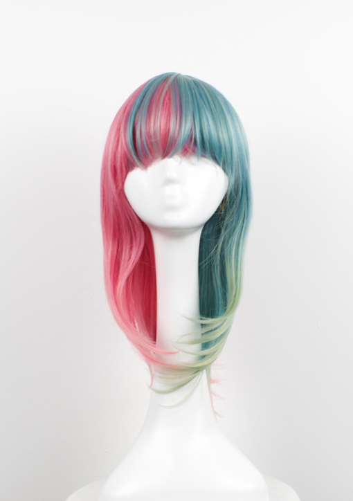 Pink and green split long bob wig. Candy split takes on the dramatic colour divide. These super cute pastel pink and green colours. Split down the centre parting and carry the colour through the fringe. Styled straight with plenty of volume and texture.