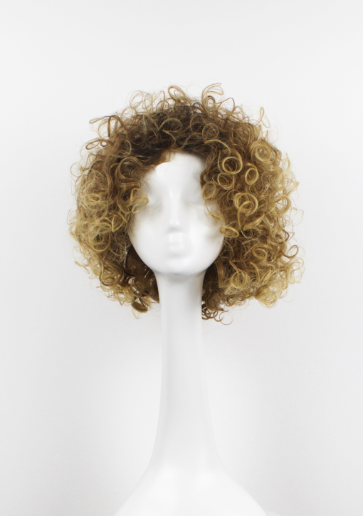 Blonde short curly wig. Calling all dancing queens! Stargaze is a vibrant and fresh style. Dark brown roots with ash blonde locks. This tight spiral curl wig is perfect for those who want to try a mop of curls without hours of styling!