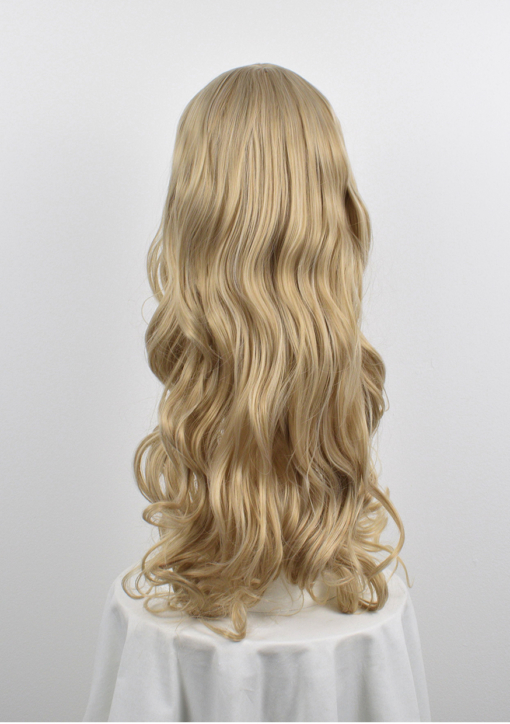 Long curly blonde with fringe wig. Callisto gives a cool and natural ethereal tone. The diamond blonde shade is styled with delicate waves for body and movement.