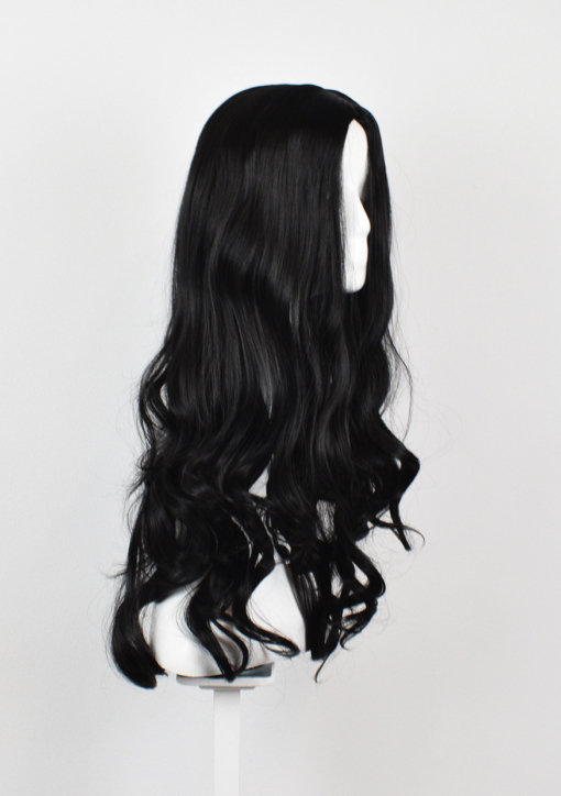 Black long wig with curls. Caviar is the epitome of glamour. This nocturnal black shade is styled sleek, and finishes in beautiful tumbling curls.