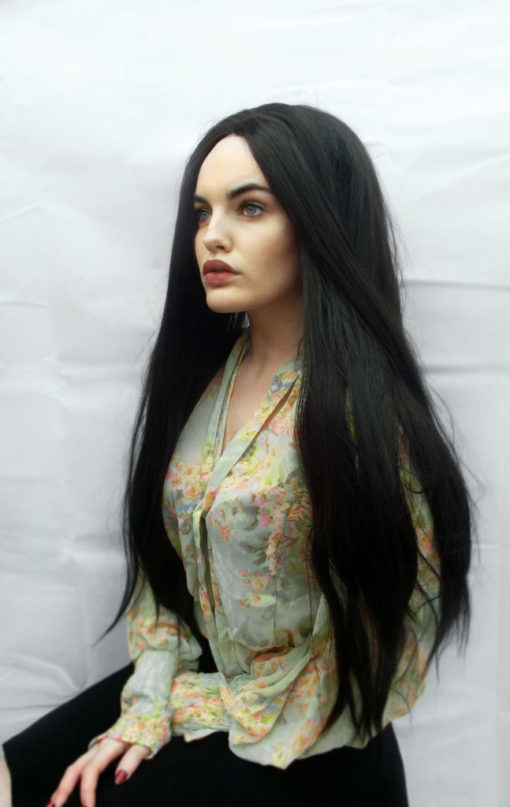 Black extra long straight lace front wig. Farrow is the ultimate in gothic expression. A cool black colour from roots to ends. This straight sleek style has layers for volume and movement. Create you own Hairstyles for extra impact.