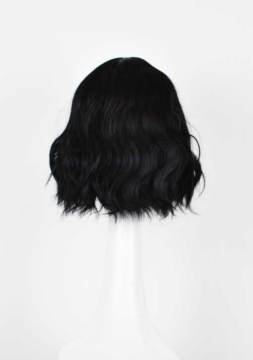 Black wavy bob wig with bangs. Black Tea is a natural and simple style that comes in a warm black shade, from roots to tips. Styled in tousled waves to give texture and body.