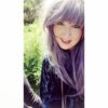 Purple wavy long wig with bangs. Washed up mermaid is a deep lilac colour from roots to tips. Long and luscious set in loose waves that fall to the waist. A long thick fringe to add extra layers to the face.
