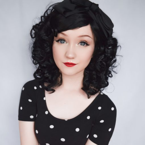 Big, bouncy jet black curls that fall just above the shoulders, Havana can be worn loose and neat or teased high and wild! No defined parting means this one is perfect for an undone curly style.