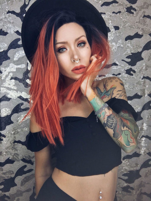Orange straight long bob lace front wig. A bold and chic look. Valencia has cool black roots that melt into a bright burnt orange colour. A centre parting and poker straight locks that fall just past the shoulders, finishes this chic style.