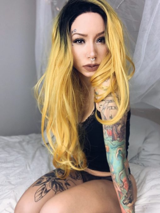 Yellow long straight lace front wig. Sunflower is Bold and beautiful. With cool black shadow roots that blend into a striking yellow blonde shade.