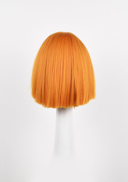 Bright orange yellow choppy bob wig. Azul gives us the brightest orange sunshine, we love it! This wig is a perfect pop of colour for a quirky look, falling just to the jawline. It has a blunt fringe and a very blunt finish to it, making it quirky and cute.