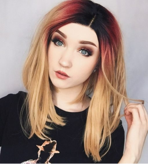 Blonde reverse contrast colour lace front wig. Lucille is a playful take colour. It's unusual and cute, with black shadowed roots and a touch of red reinvents this honey blonde style.