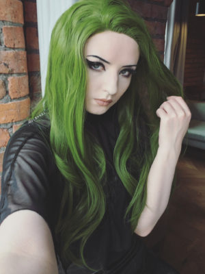 Green long lace front wig. A bold swampy green colour. A very vibrant alternative look! Extra long falling to the waist.