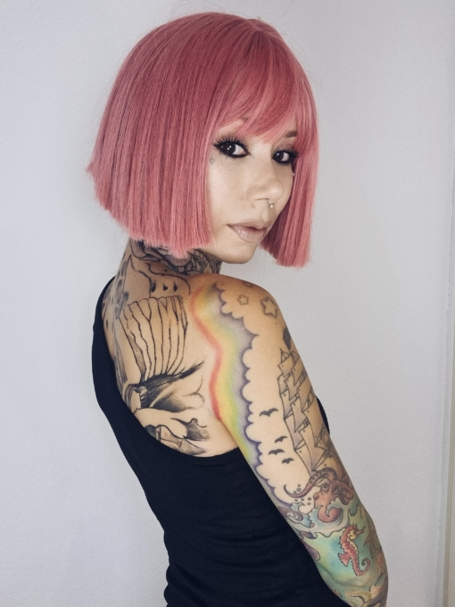 Pink straight bob wig with bangs. Make a statement in this striking style. Fresh rose hues set this poker straight blunt cut.