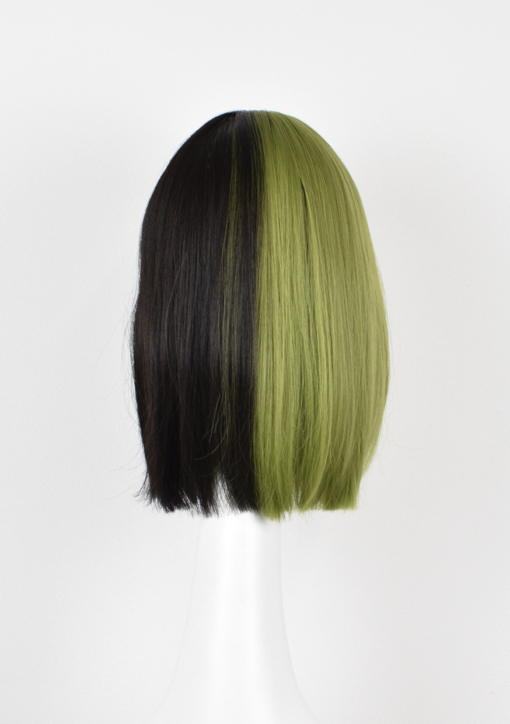 Black and green split long bob wig. Serpentine takes on the dramatic colour divide. This grungy black and green style. Split down the centre parting and carrying the colour through the fringe. Styled straight and sleek, falling just below the shoulders. Easy to wear and maintain.