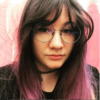 Purple long straight wig with bangs. Love Potion is sleek with layers styled in a blow out, for full body. Cool black shadowed roots give a natural feel to the look. Purple tones run through the lengths, with a washed out lilac applied to the ends for a dip dye effect, that falls to the waist.
