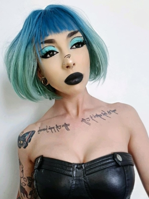 Blue and green straight bob. Tide takes a classic bob style, and gives it a futuristic twist with colour blocking. A graduated cut thats sleek and smooth and on trend with vibrant colours. Steel blue roots thats carried into the fringe, and blending into a turquoise green that will be hard not to miss!