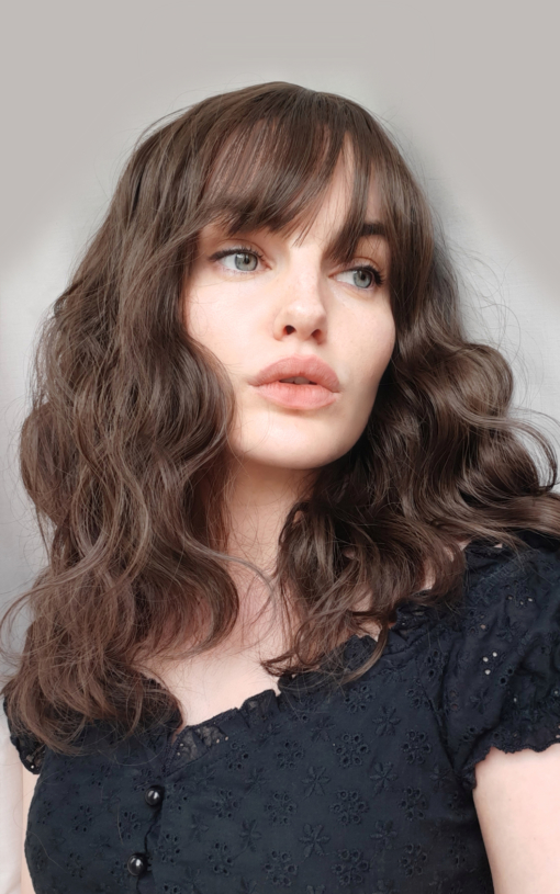 Light brown wavy long bob with bangs wig. We can't resist Matsu! This lob is a hit and one of our top trending wigs! The natural light brown shade with textured, tousled, loose curls.