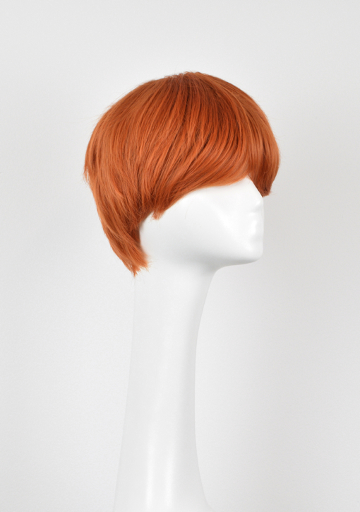 Orange short wig with bangs. Short and sweet is squash, our pixie cut that's hard to ignore with its choppy layers, giving texture and volume to the bright orange colour. Add your own touches with accessories.