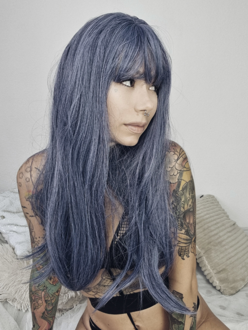 Dusky blue and lilac long straight wig with bangs. We can't get enough of this subtle multi-colour effect. Zwicky has a mix of washed out blue and lilac undertones, that's sleek.