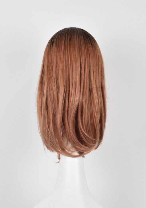 Rose gold straight bob wig with bangs. Maple is a delicious mix of blonde with pink undertones creating a unique hue. Styled in a long bob with a heavy thick fringe, framing the face and nailing this look.